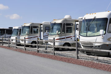 recreational vehicles at an rv dealer parking lot